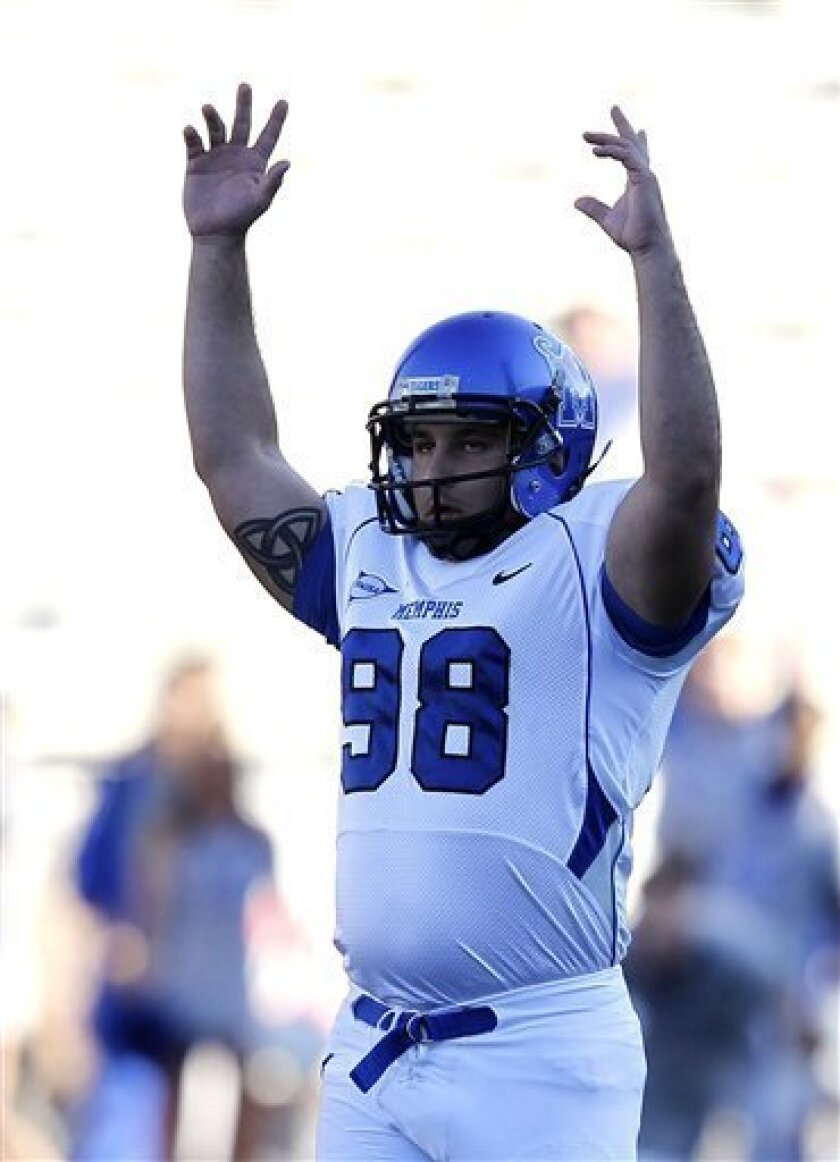 Memphis kicker Paulo Henriques (98) celebrates after making a field goal against UAB during the first half of an NCAA college football game on Saturday, Nov. 20, 2010, in Birmingham, Ala. (AP Photo/Butch Dill)
