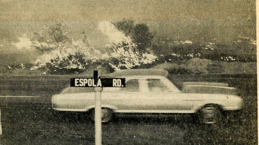 A photo from the News Chieftain shows flames along Espola Road.