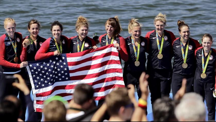 The U.S. women's eight crew, from left, Emily Regan, Kerry Simmonds, Amanda Polk, Lauren Schmetterling, Tessa Gobbo, Meghan Musnicki, Eleanor Logan, Amanda Elmore and Katelin Snyder -- celebrate after receiving their gold medals.