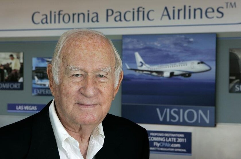 Ted Vallas, the 90-year-old founder of California Pacific Airlines, stands before his first counter at Palomar Airport in Carlsbad. The airline is currently seeking certification from the Federal Aviation Administration and hopes to be in the air in 2012.