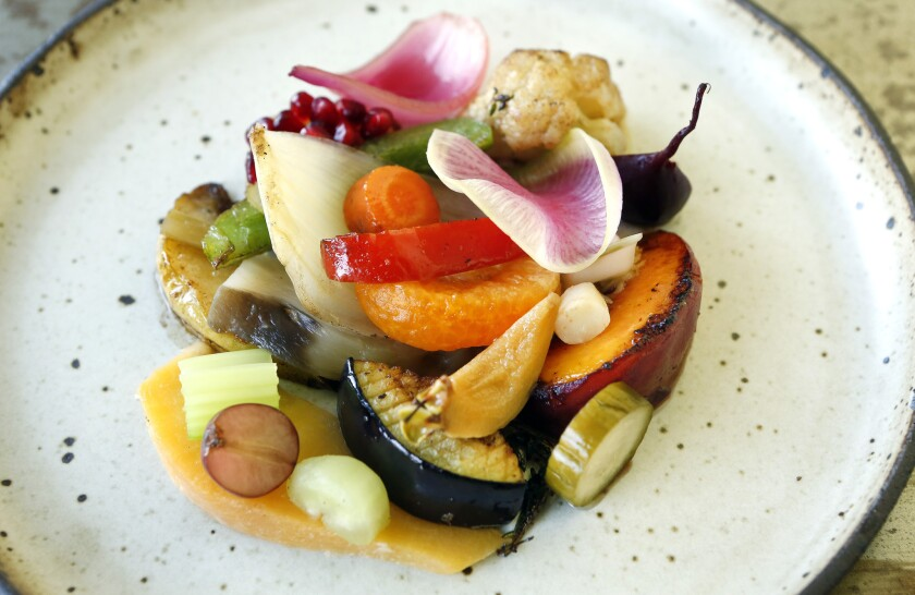 A vegetable-and-fruit plate is on the menu at Le Comptoir, located at the Hotel Normandie on 6th Street in Los Angeles.