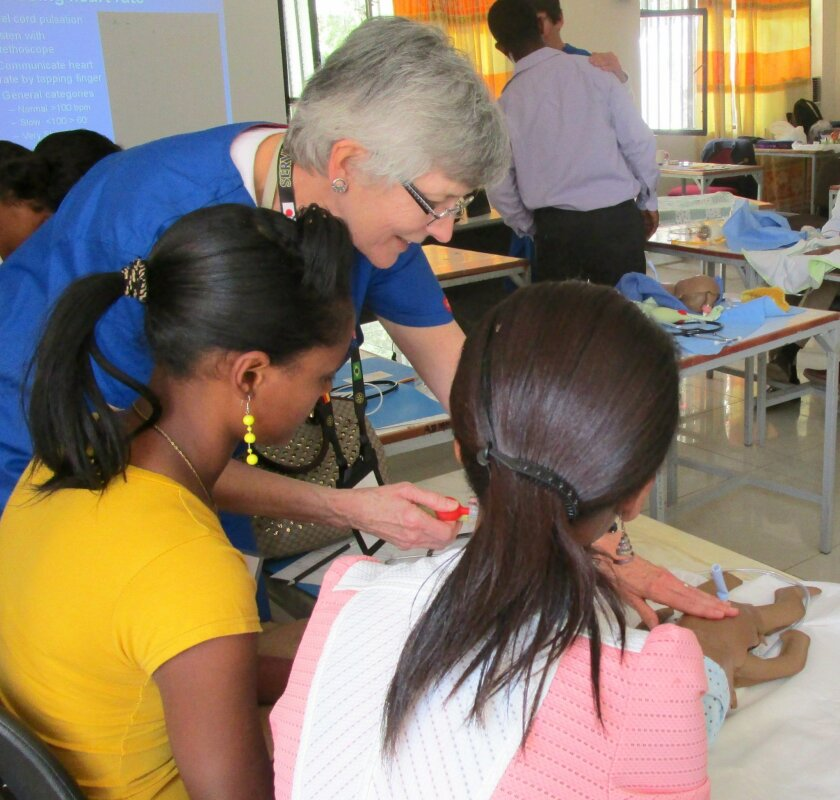 Dr. Davies demonstrates a lifesaving procedure to the Ethiopian health professionals.