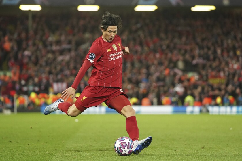 Liverpool's Takumi Minamino takes a shot during a game against Atletico Madrid on March 11.