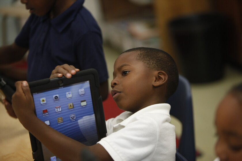 Avery Sheppard explores the possibilities with his new iPad provided by the Los Angeles Unified School District on Aug. 27, 2013.