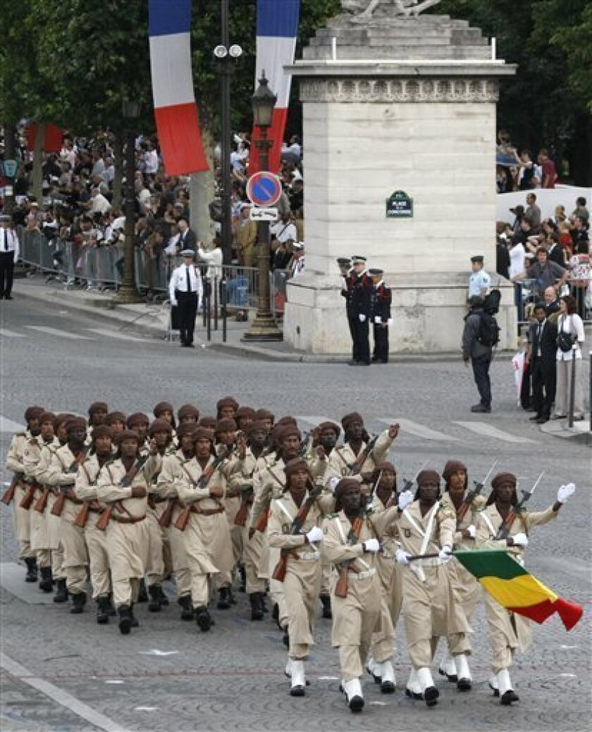 Troops from Mali parade the traditional Bastille Day military ceremony on The Champs Elysee Avenue in Paris, Wednesday, July 14, 2010. (AP Photo/Francois Mori) .