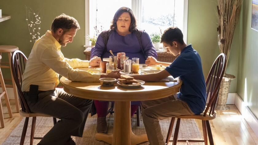 "Josh Lucas, left, Chrissy Metz and Marcel Ruiz in the movie ""Breakthrough."""