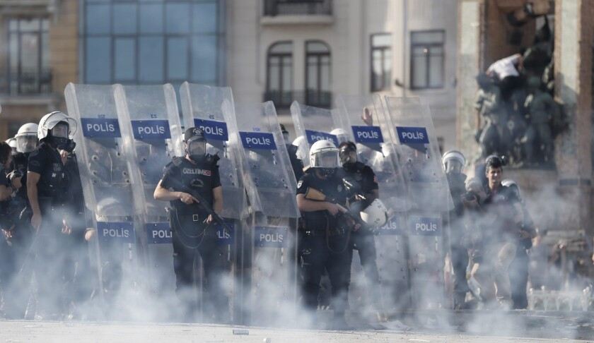 Police storm Istanbul square, clash with protesters
