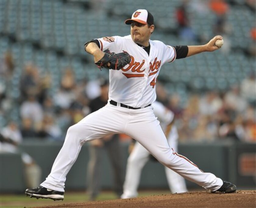 Baltimore Orioles starting pitcher Joe Saunders delivers against the Chicago White Sox in the first inning of a baseball game on Wednesday, Aug. 29, 2012, in Baltimore. (AP Photo/Gail Burton)