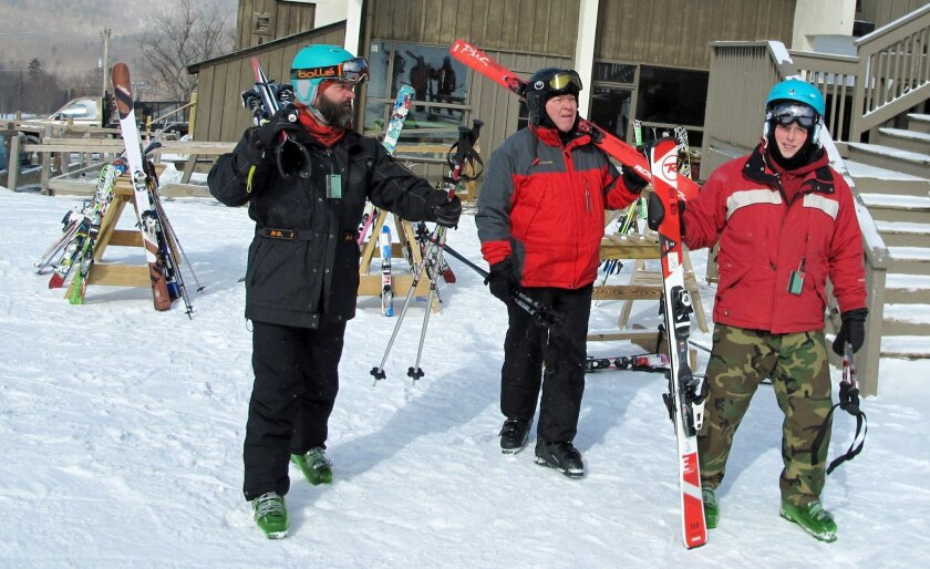 Military veterans Bryan Ashley-Selleck, left, Roger Bushey, center, and Tyler Arel, who suffer post-traumatic stress disorder, skiing together at Bolton Valley Resort in Bolton, Vt,, Thursday Feb. 18, 2016.  A group of service members of the Gulf, Iraq and Vietnam wars say the weekly gatherings thr