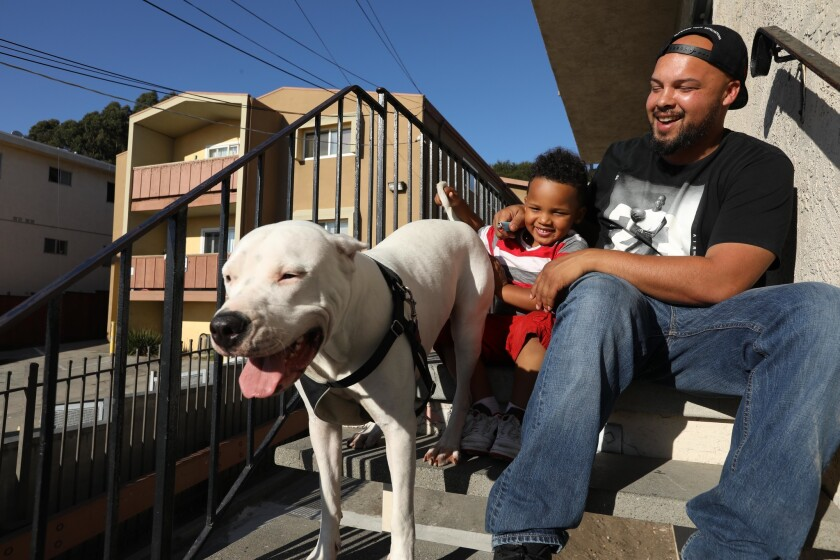 Rob Jenkins spends time with his 4-year-old son, Cash, and his dog, Sadie, at home in Oakland. He was convicted of growing marijuana a decade ago, but his record has since been expunged.