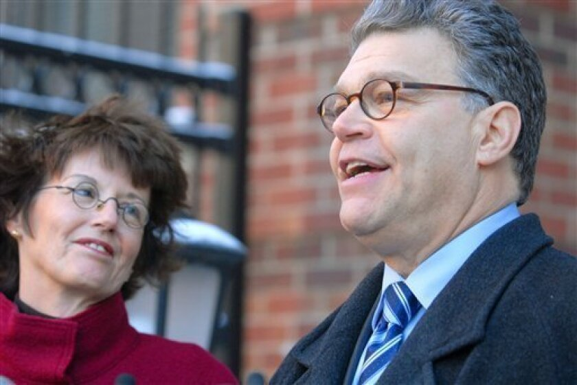 Democratic Senate candidate Al Franken, with his wife Franni at his side, speaks to members of the media Monday Jan. 5, 2009 outside his home in Minneapolis after Minnesota's Secretary of State Mark Ritchie and other members of the State Canvassing Board certified  Franken as the leader of the ra