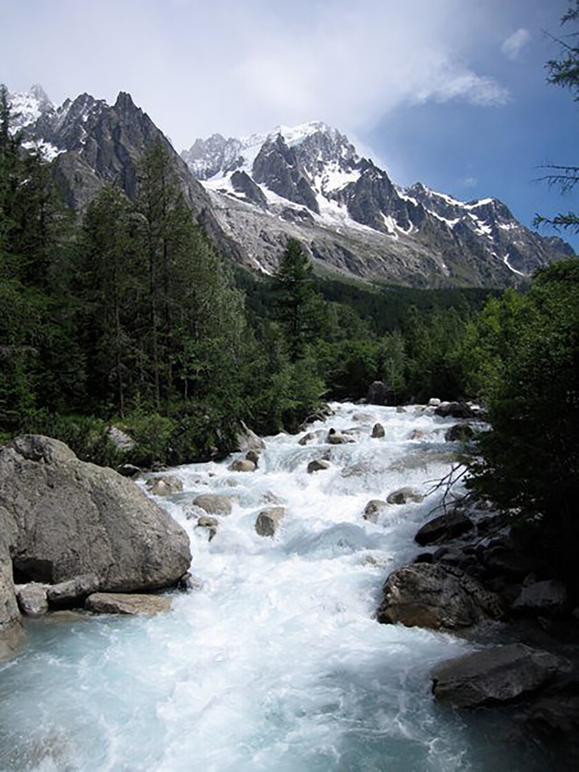 In this photo dated 2009, risk of part of the Planpincieux glacier breaking off amid climate warming in the Alps has prompted Italian authorities to forbid hikers and tourists from a section of the Val Ferrat area, shown in this June 2009 photo from the famed Tour du Mont Blanc trail outside Courmayeur, Italy. The fast-moving Italian glacier is melting quickly, threatening the picturesque valley near the Alpine town of Courmayeur and prompting Mayor Stefano Miserocchi to close down a mountain road. (AP Photo / Randall Hackley)