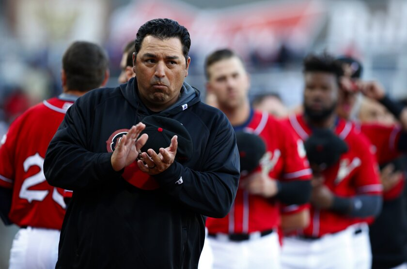El Paso Chihuahuas manager Rod Barajas applauds before the start of an exhibition baseball game against the San Diego Padres in El Paso, Texas, Thursday, March 31, 2016.
