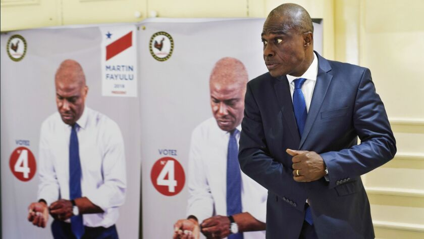 Congolese opposition presidential candidate Martin Fayulu prepares for an interview with the Associa