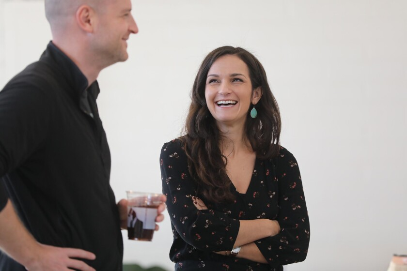 Morgan Spenla, right, founder of The Crafter's Box, and videographer Dustin Bailey chatted during a break in recording at a studio in North Park.