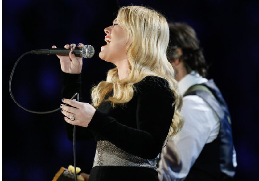 Singer Kelly Clarkson, performing at the 2013 Grammy Awards, may not get to take possession of the Jane Austen ring she bought at auction last year.