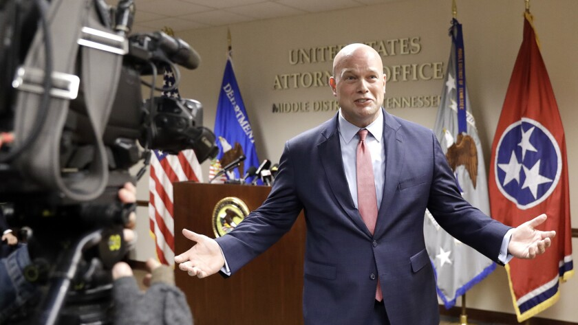 Acting Atty. Gen. Matthew Whitaker jokingly asks for questions as he leaves a news conference where no questions were allowed Thursday in Nashville, Tenn.