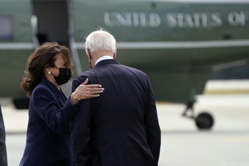 President Biden talks with Vice President Kamala Harris.