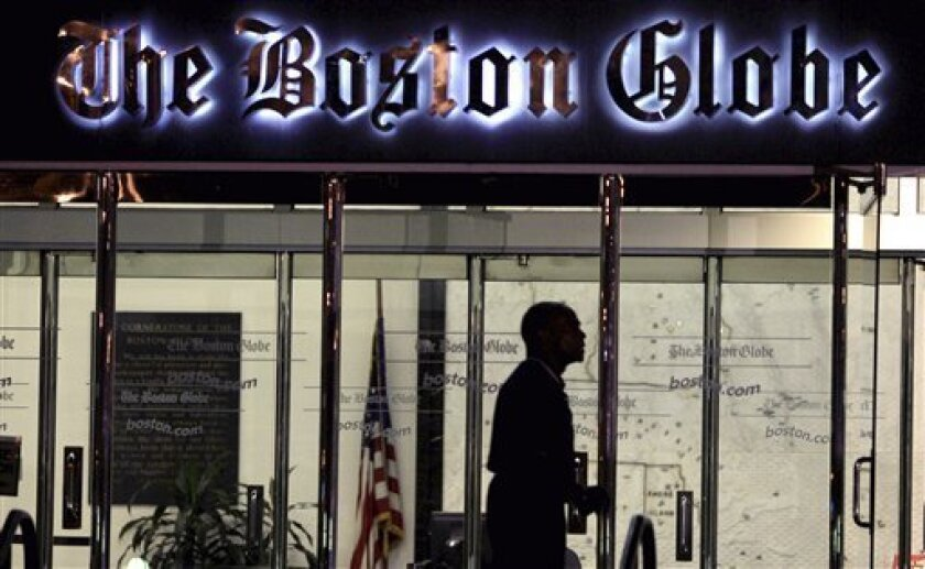 FILE - In this July 20, 2009 file photo, a security guard walks past the entrance of The Boston Globe building in the Dorchester neighborhood of Boston. The New York Times Company, which owns The Globe, announced Wednesday, Feb. 20, 2013, that it has put The Globe up for sale. (AP Photo/Charles Kru