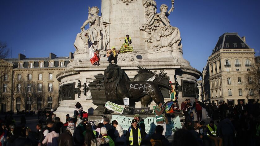 Yellow vest protesters during a protest in Paris, Sunday, Feb.17, 2019 in Paris. French yellow vest