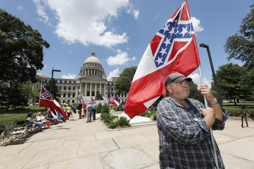 David Flynt of Hattiesburg waves flag outside state Capitol in Jackson, Miss., Sunday,