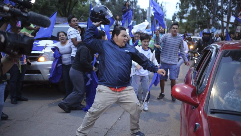 Supporters of Honduran President Juan Orlando Hernandez protest in Tegucigalpa, the capital, on Monday.