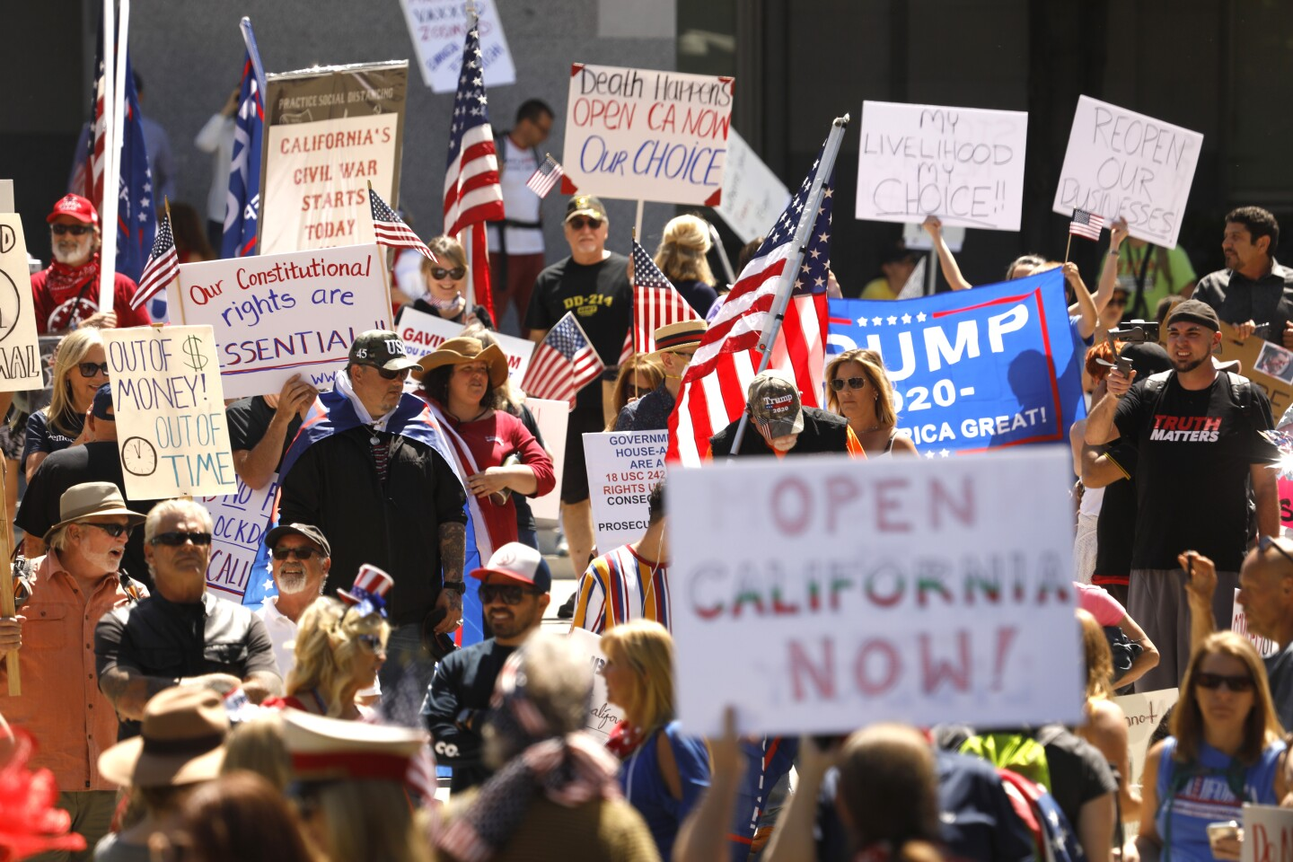 SACRAMENTO,CALIFORNIA--MAY 1, 2020-- Over 1,500 people attending a rally at the capitol in Sacramento asking for the civil liberties and the opening of the economy, closed due to the coronavirus. (Carolyn Cole/Los Angeles Times)