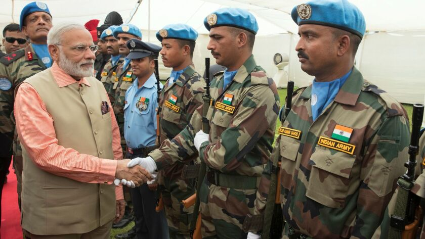 Indian Prime Minister Narendra Modi greets Indian soldiers deployed with the U.N. peacekeeping force