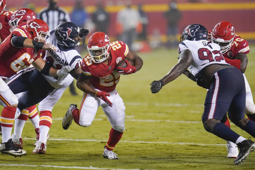 Kansas City Chiefs running back Clyde Edwards-Helaire (25) carries the ball against the Houston Texans.