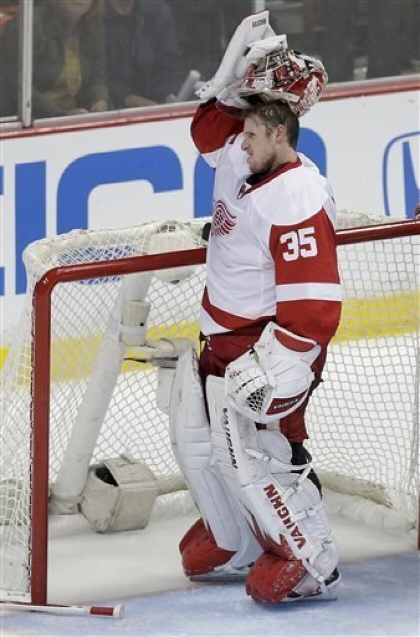 Detroit Red Wings goalie Jimmy Howard reacts after getting kicked in the head by Anaheim Ducks right wing Corey Perry during the second period in Game 1 of their first-round NHL hockey Stanley Cup playoff series in Anaheim, Calif., Tuesday, April 30, 2013. (AP Photo/Chris Carlson)