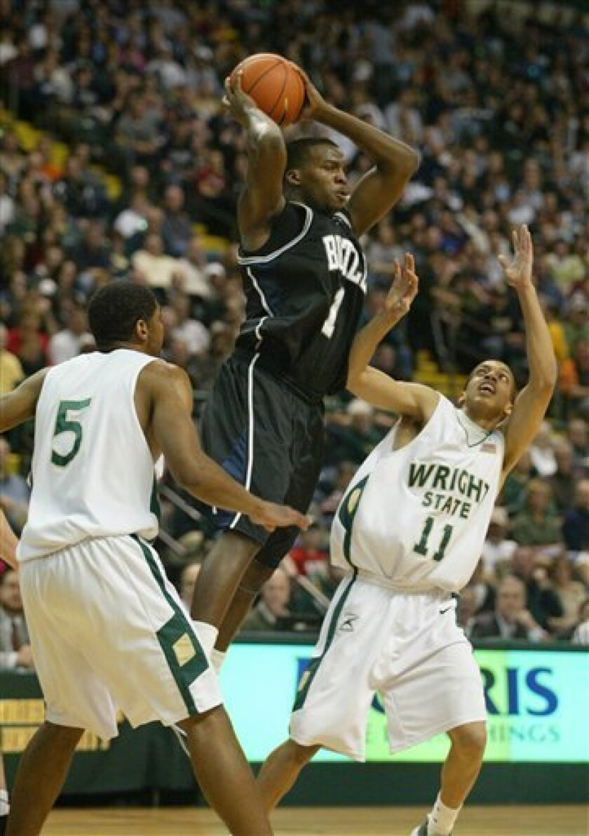 Butler's Shelvin Mack (1) looks to pass between Wright State's Cory Cooperwood (5) and N'Gai Evans (11) in the first half of an NCAA college basketball game Saturday, Feb. 7, 2009, in Dayton, Ohio. (AP Photo/Skip Peterson)