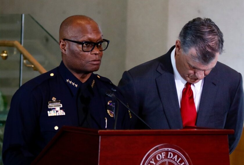 Dallas Police Chief David Brown, left, and Dallas Mayor Mike Rawlings answer questions from the media during a news conference in Dallas on Friday.