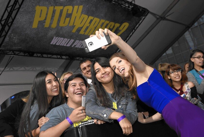 """Actress Anna Kendrick takes a selfie with fans at the world premiere of """"Pitch Perfect 2"""" at the Nokia Theatre last week."""