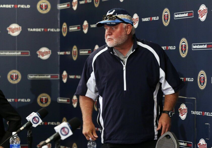 Former Minnesota Twins manager Ron Gardenhire looks out to the assembled at a baseball news conference officially announcing his firing, Monday, Sept. 29, 2014, in Minneapolis.