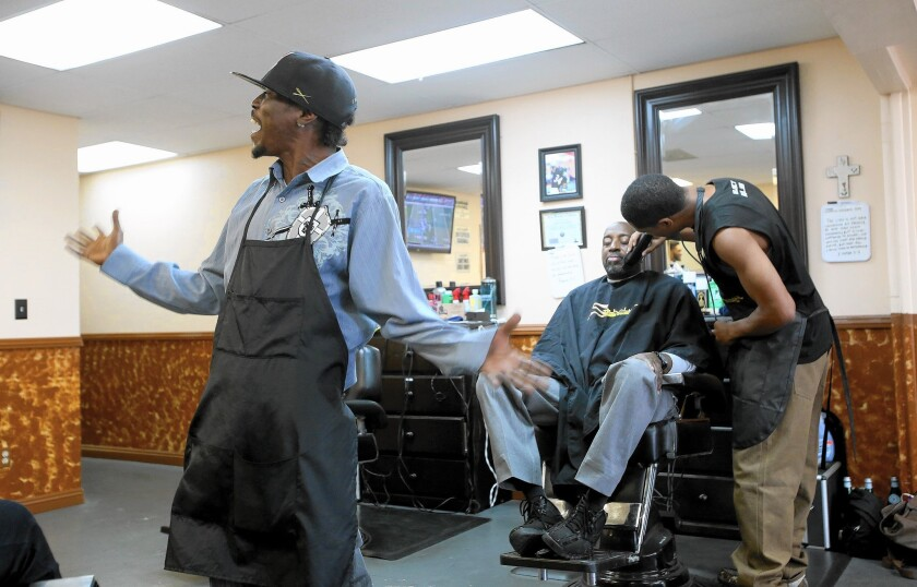 Barbers at Stakely's Barbershop say they've been hit hard by construction of the Crenshaw-LAX light-rail line, which has forced street closures and blocked the sidewalk since it began about a year ago.