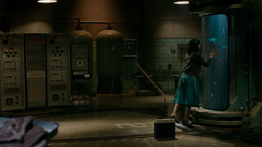 "Sally Hawkins stars as a mute cleaning woman at a 1960s government facility who feels a connection to a mysterious creature played by Doug Jones in ""The Shape of Water."""