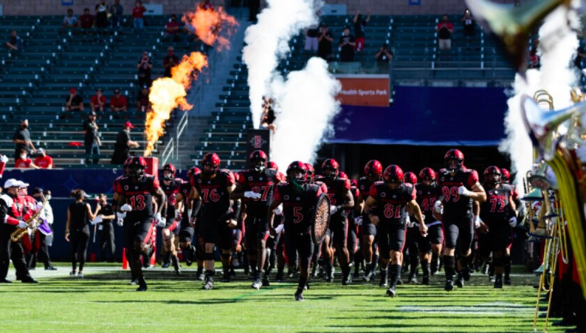 San Diego State players run onto the field at Dignity Health Sports Park.