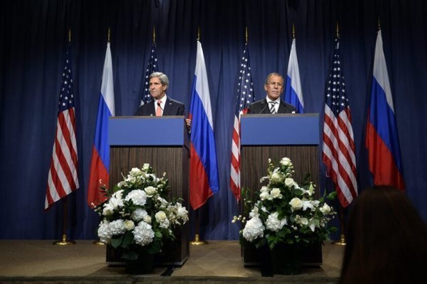 Secretary of State John F. Kerry, left, and Russian Foreign Minister Sergei Lavrov speak in Geneva after reaching a deal on Syrian chemical weapons.