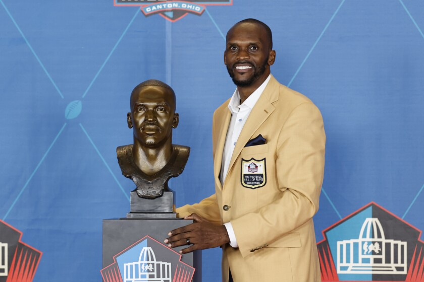 Isaac Bruce poses with his bust during the Pro Football Hall of Fame induction ceremony Aug. 7, 2021, in Canton, Ohio.