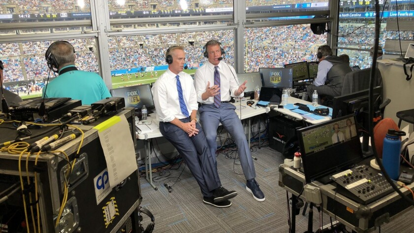 Troy Aikman (right) in the press pox