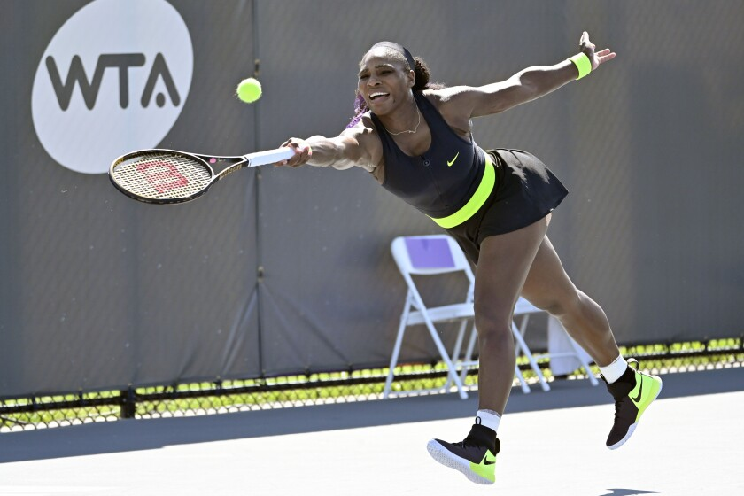 Serena Williams reaches for a shot in her match against Shelby Rogers on Aug. 14, 2020.