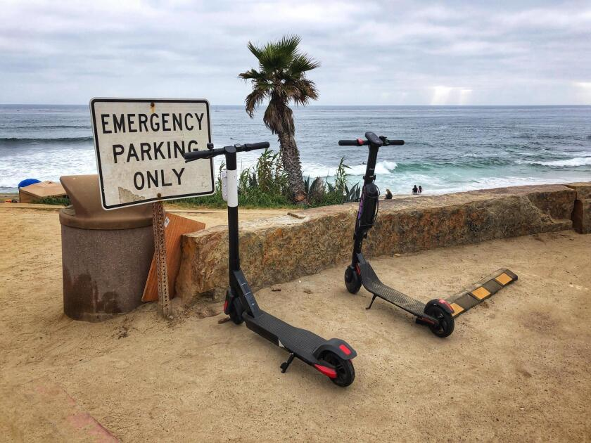 SAD SCOOTER SPOTTINGS: I took this photo Sunday, July 7 at Windansea Beach. These dockless electric scooters certainly don't add to the beauty of La Jolla, they add to the concerns that are tarnishing our Jewel. — Cliff Oliver, photography instructor at the Athenaeum