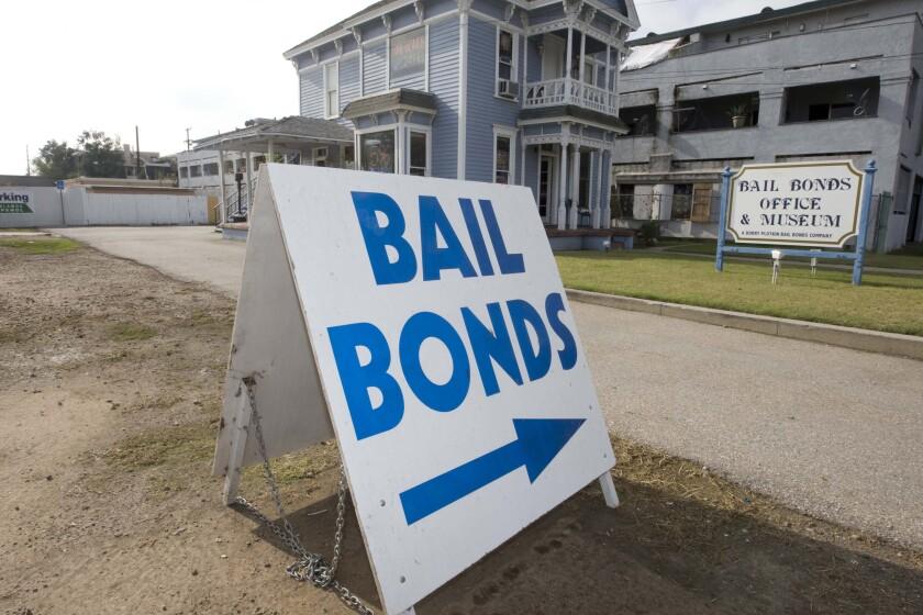 A bail bond office displays a sign near a California jail.