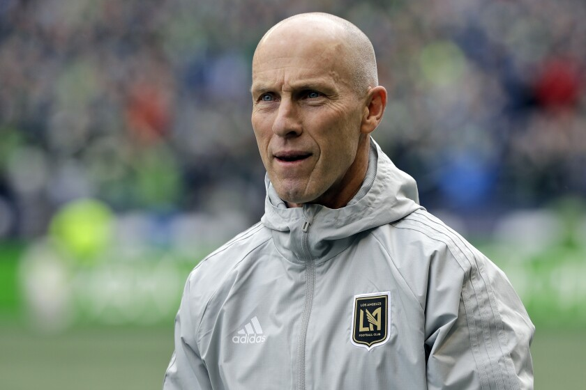 FILE - In this March 4, 2018, file photo Los Angeles head coach Bob Bradley walks across the pitch.