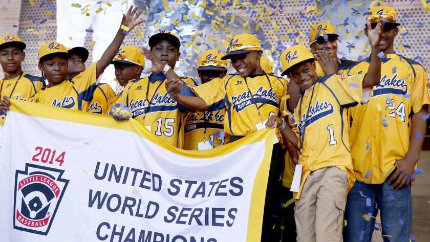 Jackie Robinson West Little League players attend a rally in celebration of their national title in Chicago on in August. Jackie Robinson West was stripped of its championship by Little League International on Wednesday.
