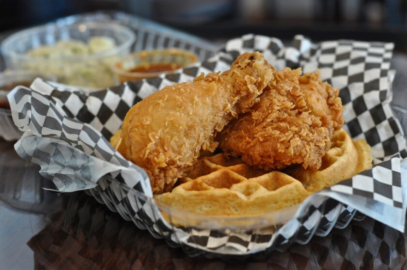 A combo order at Mabel's in downtown L.A. comes with two pieces of fried chicken, a waffle, one side, a syrup, a dipping sauce for the chicken and a drink.