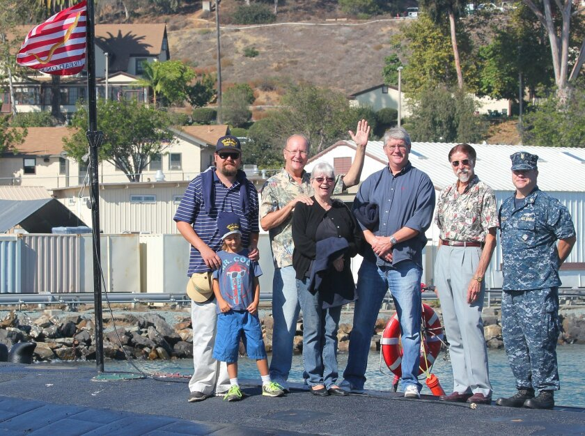Tyler and Tyrus Nelson, Town Council trustees Ron Jones, Cathy Jones and Peter Wulff, Town Council member Lawrence Zynda and Navy tour guide Joseph Bransfield pose atop the USS La Jolla oct. 23.