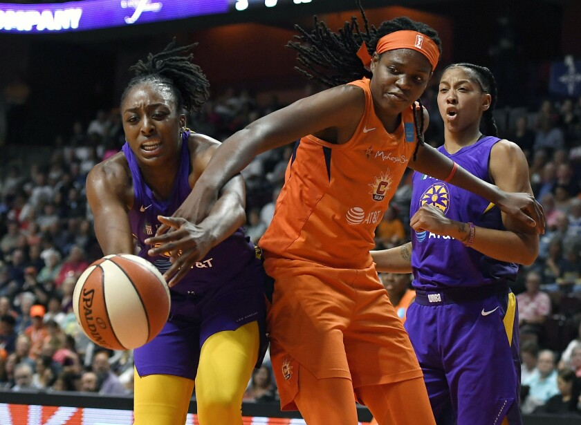 Sparks forward Nneka Ogwumike, left, and Connecticut's Jonquel Jones battle for the ball during Game 1 of the WNBA semifinals on Tuesday.
