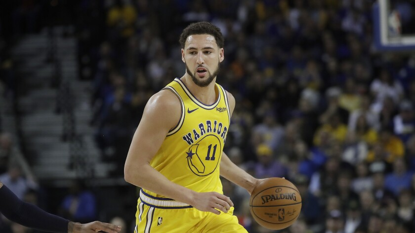 Golden State Warriors guard Klay Thompson plays against the Denver Nuggets.