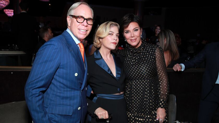 Tommy Hilfiger, from left, honoree Selma Blair and Kris Jenner attend the 26th Race to Erase MS gala in Beverly Hills on Friday night.